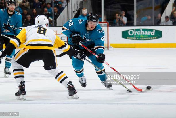 Tomas Hertl of the San Jose Sharks skates with the puck against Brian Dumoulin of the Pittsburgh Penguins at SAP Center on January 20 2018 in San...