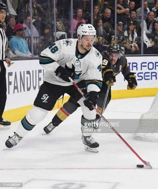 Tomas Hertl of the San Jose Sharks skates with the puck against Reilly Smith of the Vegas Golden Knights in the first overtime period of Game Six of...