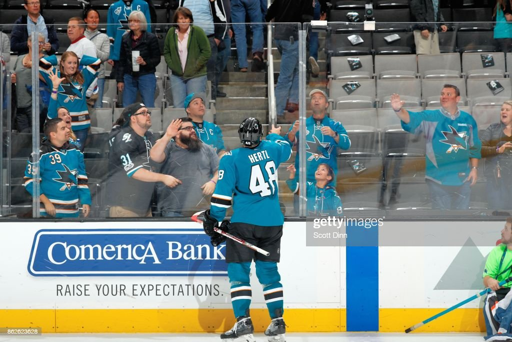 Tomas Hertl #48 of the San Jose Sharks, third star of the game, tosses a puck to a fan at SAP Center on October 17, 2017 in San Jose, California.