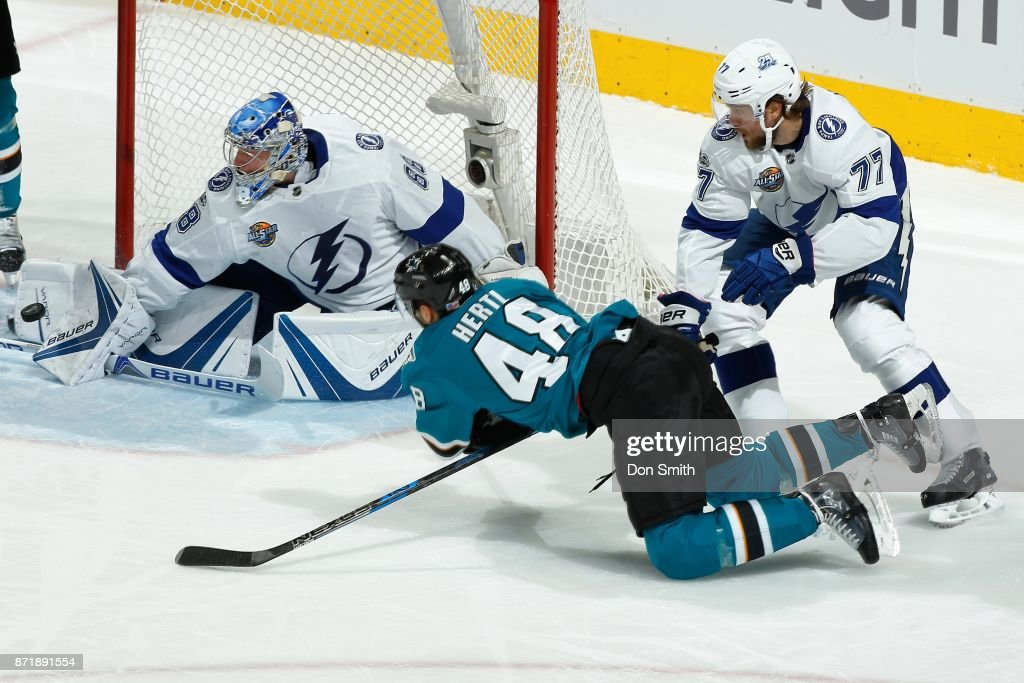 Tomas Hertl #48 of the Tampa Bay Lightning is defended by Victor Hedman #77 of the Tampa Bay Lightning as Andrei Vasilevskiy #88 of the Tampa Bay Lightning protects the net at SAP Center on November 8, 2017 in San Jose, California.
