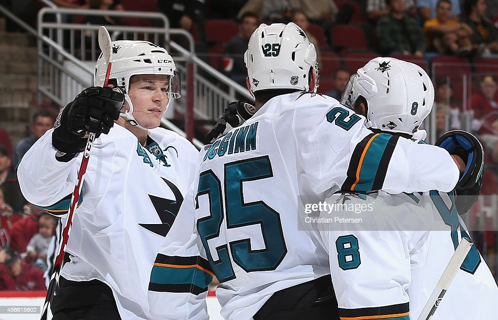 Tomas Hertl #48, Tye McGinn #25, and Joe Pavelski #8 of the San Jose Sharks celebrate after McGinn scored a third period goal against the Arizona Coyotes during the preseason NHL game at Gila River Arena on October 3, 2014 in Glendale, Arizona. The Sharks defeated the Coyotes 3-1.