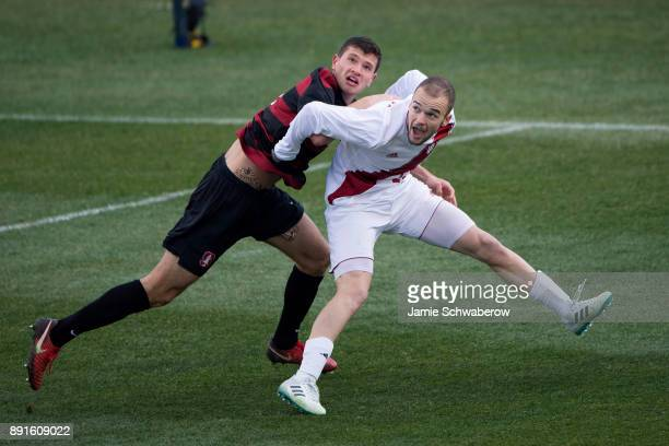 Tomas HilliardArce of Stanford University and Andrew Gutman of Indiana University battle for position during the Division I Men's Soccer Championship...