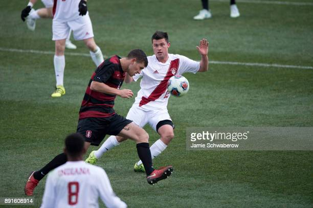 Tomas HilliardArce of Stanford University heads the ball past Austin Panchot of Indiana University during the Division I Men's Soccer Championship...