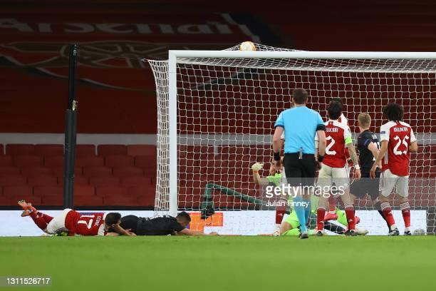 Tomas Holes of Slavia Praha scores their side's first goal past Bernd Leno of Arsenal during the UEFA Europa League Quarter Final First Leg match...