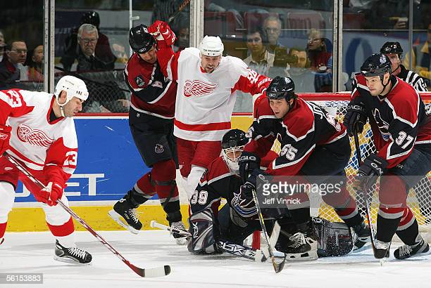 Tomas Holmstom of the Detroit Red Wings, Dan Cloutier, Jarkko Ruutu, Sami Salo, and Ed Jovanovski of the Vancouver Canucks look on as Mathieu...