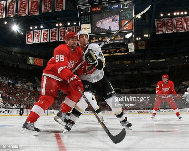 Tomas Holmstrom of the Detroit Red Wings battles with Brooks Orpik of the Pittsburgh Penguins during a NHL preseason game at Joe Louis Arena on...