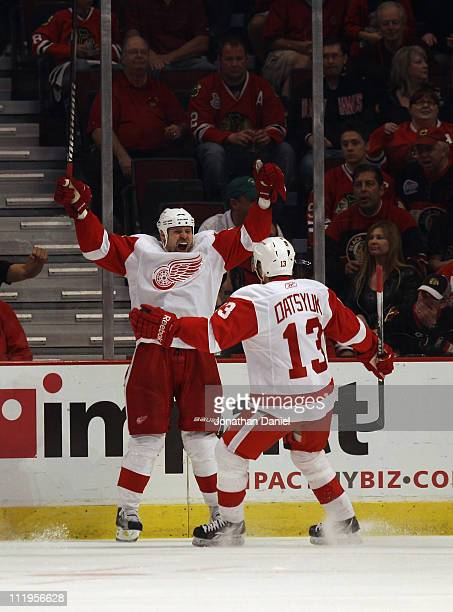 Tomas Holmstrom of the Detroit Red Wings celebrates a 2nd period goal with teammate Pavel Datsyuk against the Chicago Blackhawks at the United Center...