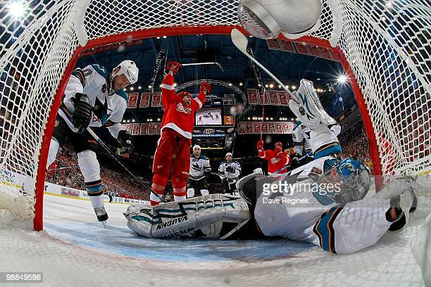 Tomas Holmstrom of the Detroit Red Wings celebrates after scoring on Evgeni Nabokov of the San Jose Sharks during Game Three of the Western...