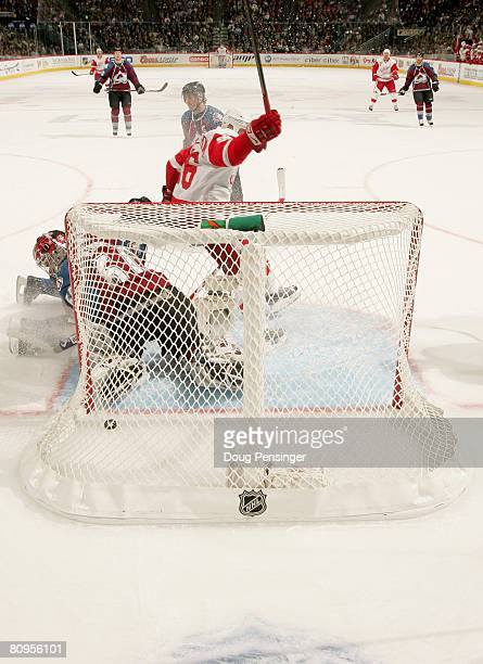 Tomas Holmstrom of the Detroit Red Wings celebrates his first period goal against goaltender Jose Theodore of the Colorado Avalanche during Game Four...