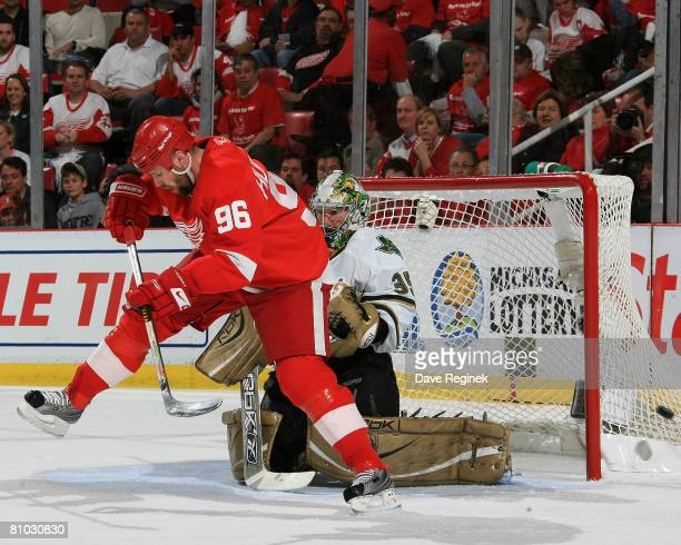 Tomas Holmstrom of the Detroit Red Wings defelects the puck wide of the Dallas Stars goal during game one of the Western Conference Finals of the...