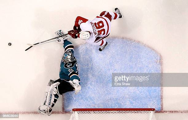 Tomas Holmstrom of the Detroit Red Wings is stopped by Evgeni Nabokov of the San Jose Sharks in Game Two of the Western Conference Semifinals during...