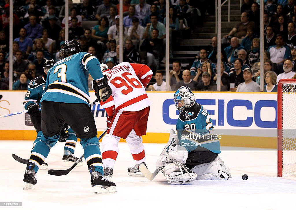 Tomas Holmstrom #96 of the Detroit Red Wings scores a goal on Evgeni Nabokov #20 of the San Jose Sharks in Game Two of the Western Conference Semifinals during the 2010 NHL Stanley Cup Playoffs at HP Pavilion on May 2, 2010 in San Jose, California.