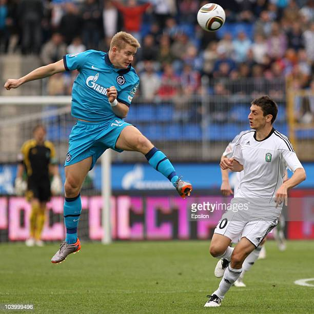 Tomas Hubocan of FC Zenit St Petersburg battles for the ball with Goran Maznov of FC Tom Tomsk during the Russian Football League Championship match...