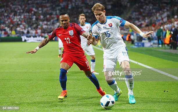 Tomas Hubocan of Slovakia and Nathaniel Clyne of England compete for the ball during the UEFA EURO 2016 Group B match between Slovakia and England at...
