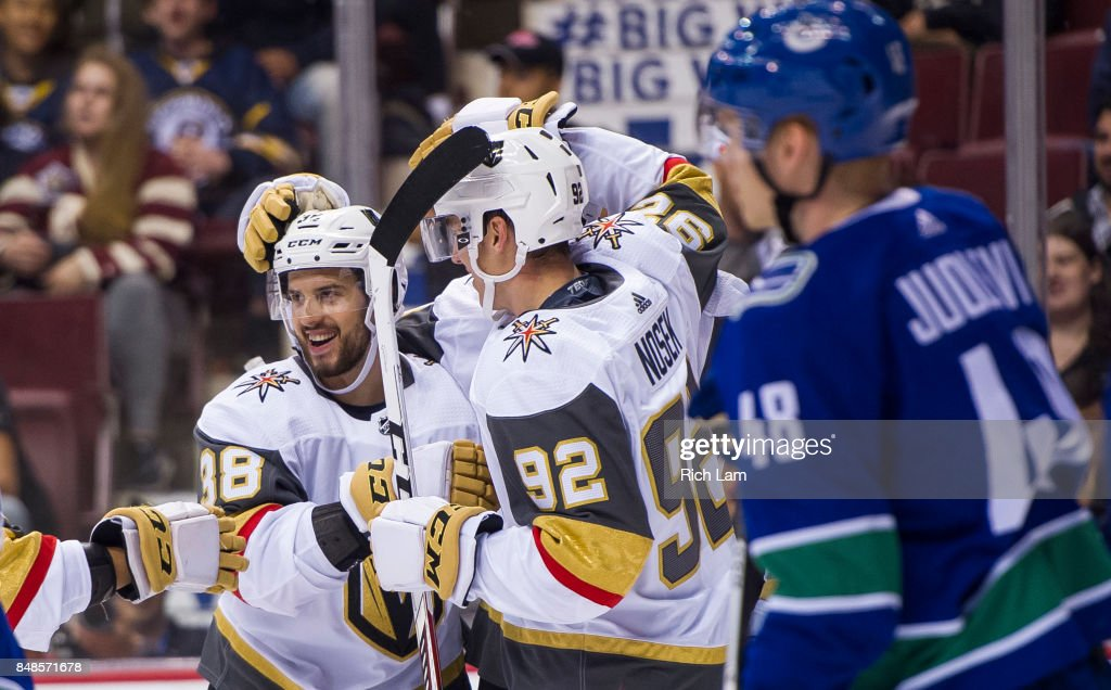 Tomas Hyka #38 of the Vegas Golden Knights is congratulated by teammate Tomas Nosek #92 after scoring a goal as Olli Juolevi #48 of the Vancouver Canucks skates past in NHL pre-season action on September 17, 2017 at Rogers Arena in Vancouver, British Columbia, Canada.