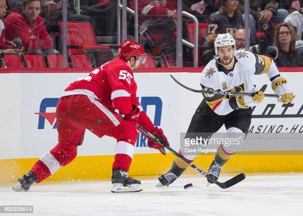 Tomas Hyka of the Vegas Golden Knights passes the puck past Niklas Kronwall of the Detroit Red Wings during an NHL game at Little Caesars Arena on...