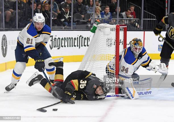 Tomas Hyka of the Vegas Golden Knights tries to control the puck after getting upended by Tyler Bozak of the St Louis Blues as Jake Allen of the...