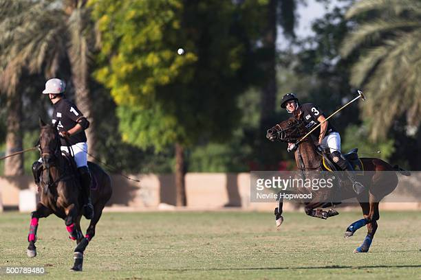 Tomas Iriarte of Habtoor polo team hits an arial ball down field on the third day of the Cartier International Dubai Polo Challenge 11th edition at...