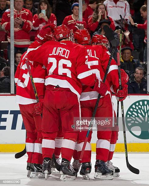 Tomas Jurco Niklas Kronwall Pavel Datsyuk and Stephen Weiss of the Detroit Red Wings congratulate teammate Tomas Tatar after scoring a powerplay goal...