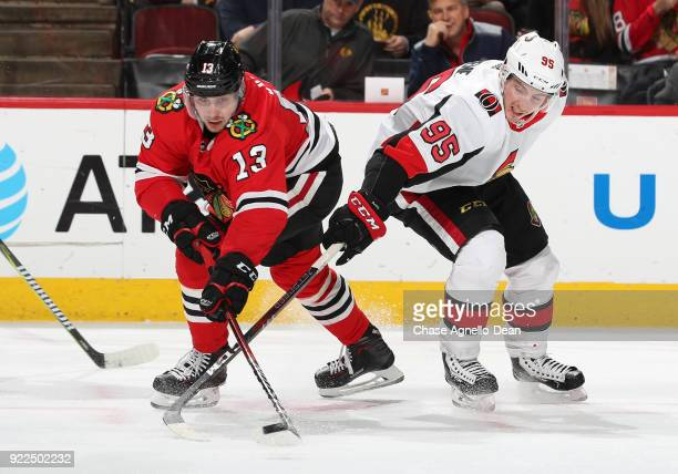 Tomas Jurco of the Chicago Blackhawks and Matt Duchene of the Ottawa Senators battle for the puck in the first period at the United Center on...