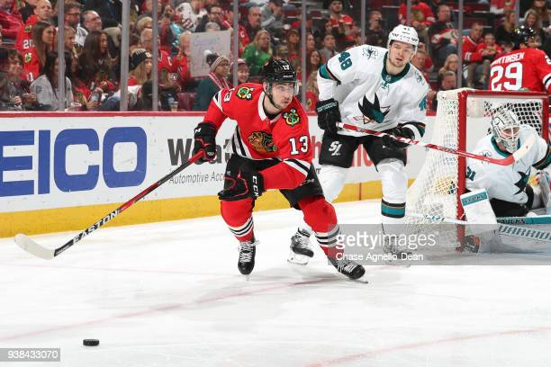 Tomas Jurco of the Chicago Blackhawks ans Tomas Hertl of the San Jose Sharks chase the puck in the second period at the United Center on March 26...