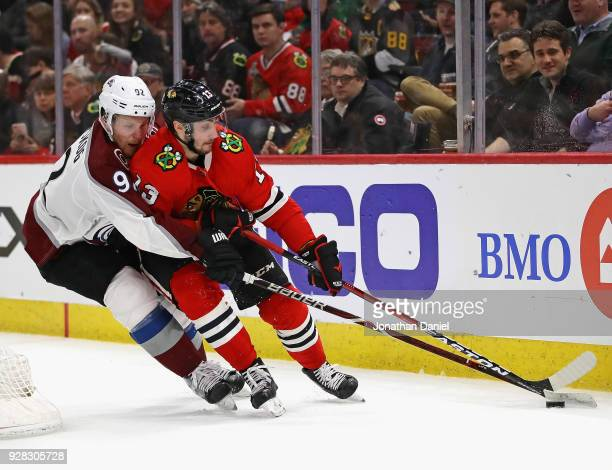 Tomas Jurco of the Chicago Blackhawks is pressured by Gabriel Landeskog of the Colorado Avalanche at the United Center on March 6 2018 in Chicago...