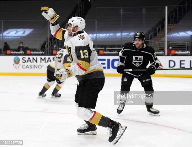 Tomas Jurco of the Vegas Golden Knights grabs the puck out of the air in front of Christian Wolanin of the Los Angeles Kings during the first period...