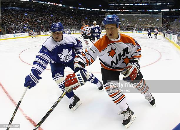 Tomas Kaberle defends against Adam Graves during the 2016 Hockey Hall of Fame Legends Classic game at the Air Canada Centre on November 13 2016 in...