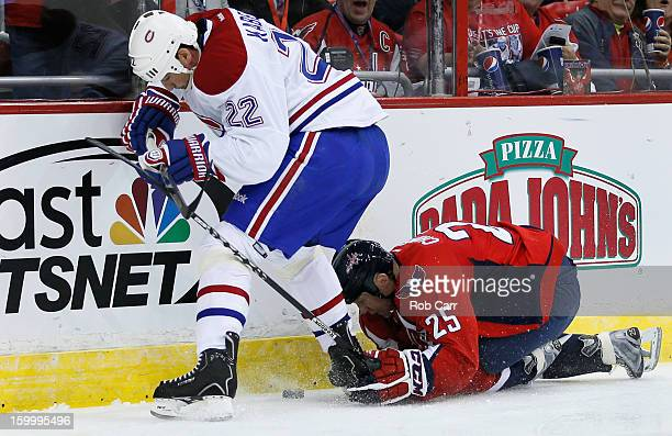 Tomas Kaberle of the Montreal Canadiens and Jason Chimera of the Washington Capitals go after the puck during the third period at Verizon Center on...