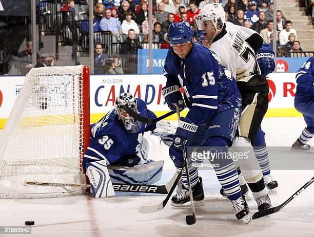 Tomas Kaberle of the Toronto Maple Leafs battles with Evgeni Malkin of the Pittsburgh Penguins during a NHL game at the Air Canada Centre on October...