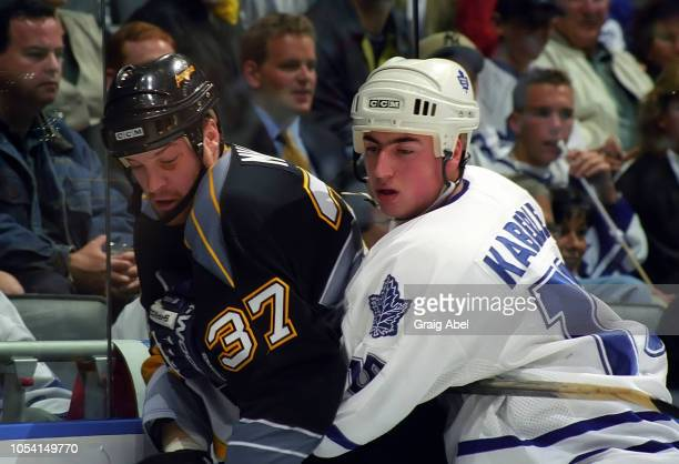 Tomas Kaberle of the Toronto Maple Leafs skates against Kip Miller of the Pittsburgh Penguins during the 1999 Quarter Finals of the NHL playoff game...