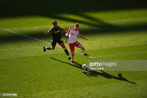 Tomas Kalas of Bristol City is tackled by Jacob Brown of Stoke City during the Sky Bet Championship match between Bristol City and Stoke City at...