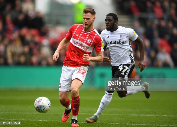 Tomas Kalas of Bristol City passes the ball with pressure from Aboubakar Kamara of Fulham during the Sky Bet Championship match between Bristol City...