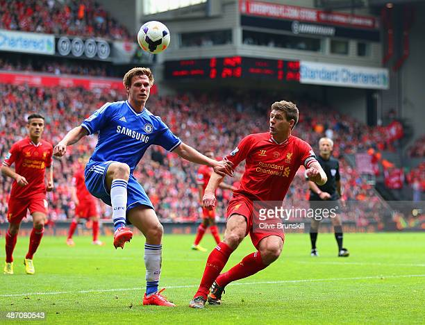 Tomas Kalas of Chelsea controls the ball under pressure from Steven Gerrard of Liverpool during the Barclays Premier League match between Liverpool...