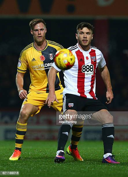 Tomas Kalas of Fulham and Scott Hogan of Brentford in action during the Sky Bet Championship match between Brentford and Fulham at Griffin Park on...