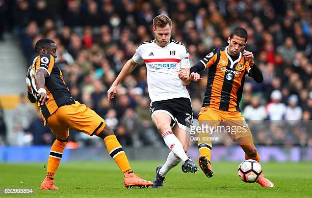 Tomas Kalas of Fulham FC and Evandro of Hull City battle for possession during The Emirates FA Cup Fourth Round match between Fulham and Hull City at...