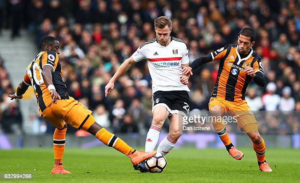 Tomas Kalas of Fulham FC Evandro of Hull City and Adama Diomande of Hull City battle for possession during The Emirates FA Cup Fourth Round match...