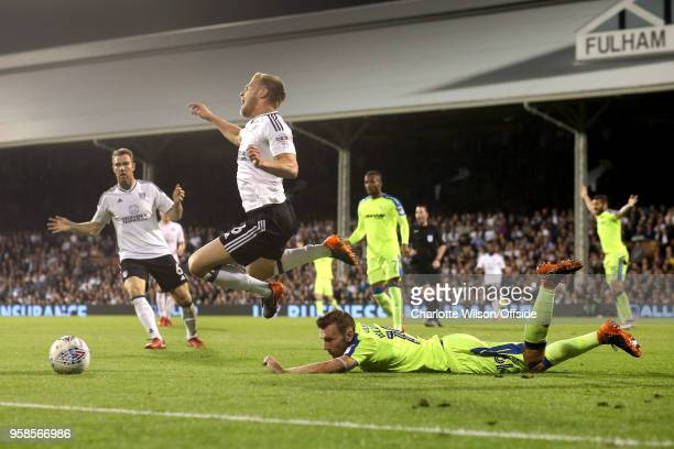 Tomas Kalas of Fulham flies through the air as he trips on a prone Andreas Weimann of Derby during the Sky Bet Championship Play Off Semi FinalSecond...