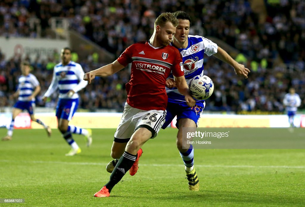 Tomas Kalas of Fulham handles the ball in the penalty area while under pressure from Yann Kermorgant of Reading and a peanlty is later awarded to Reading during the Sky Bet Championship Play Off Second Leg match between Reading and Fulham at Madejski Stadium on May 16, 2017 in Reading, England.