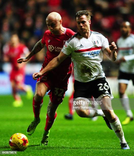 Tomas Kalas of Fulham is tackled by David Cotterill of Bristol City during the Sky Bet Championship match between Bristol City and Fulham at Ashton...