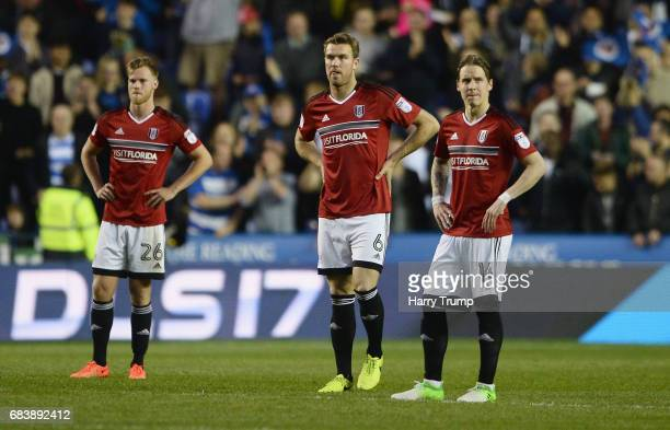Tomas Kalas of Fulham Kevin McDonald of Fulham and Stefan Johansen of Fulham are dejected after Reading score during the Sky Bet Championship Play...