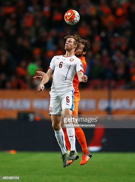Tomas Kalas of the Czech Republic jumps with Daley Blind of the Netherlands during the UEFA EURO 2016 qualifying Group A match between the...