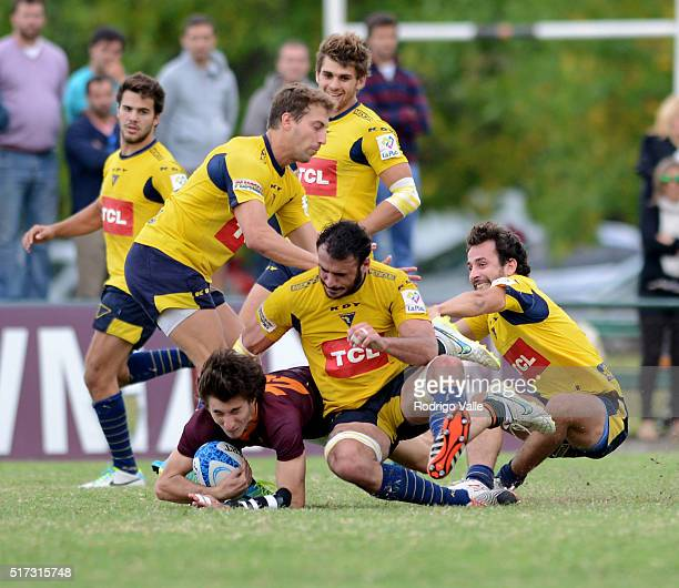 Tomas Keena of Newman is tackled by three opponents during a match between Newman and La Plata as part of ICBC Nacional de Clubes at Club Newman on...