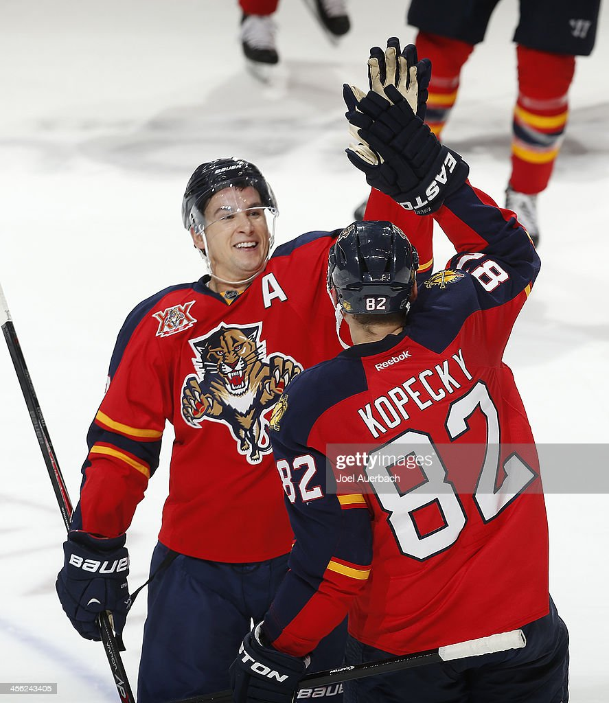 Tomas Kopecky #82 is congratulated by Scottie Upshall #19 of the Florida Panthers after he scored the game winning goal in the shootout against the Washington Capitals at the BB&T Center on December 13, 2013 in Sunrise, Florida. The Panthers defeated the Capitals 3-2 in a shootout.