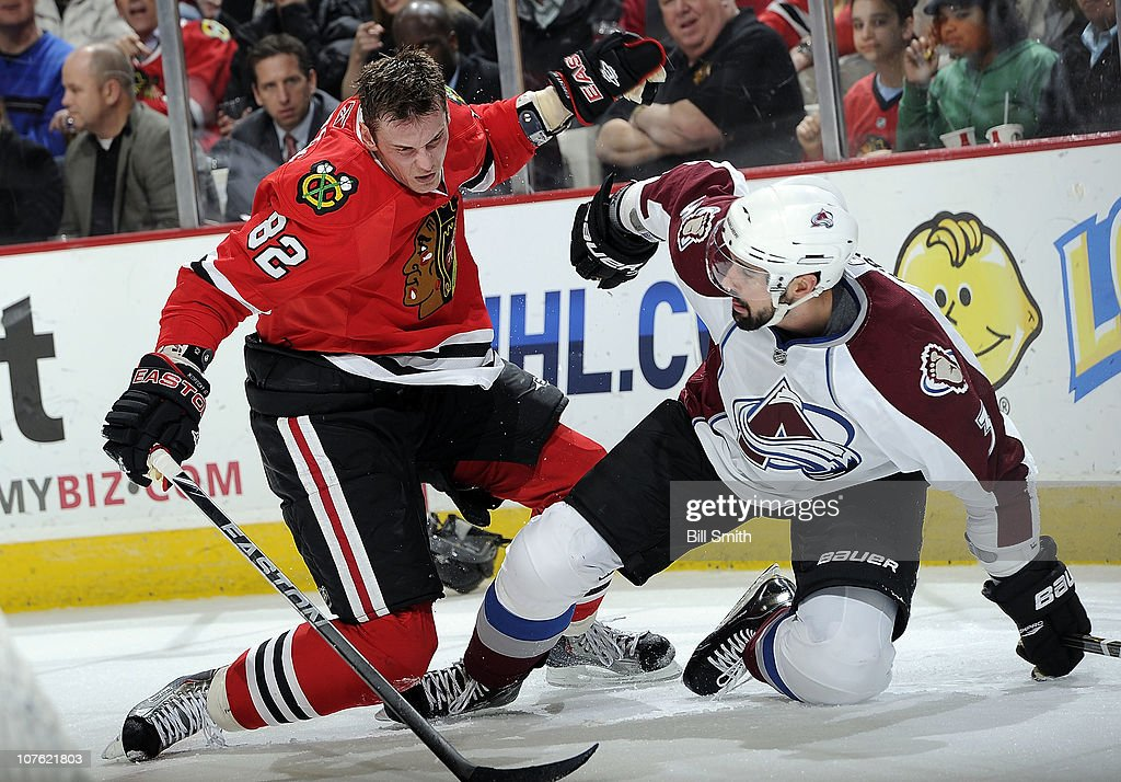 Tomas Kopecky #82 of the Chicago Blackhawks and Ryan O'Byrne #3 of