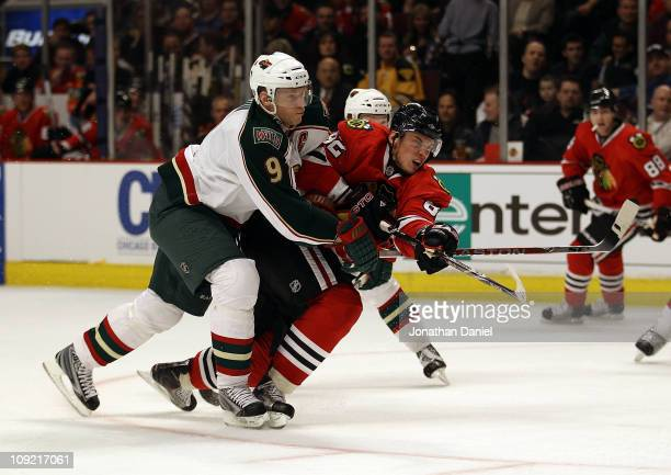 Tomas Kopecky of the Chicago Blackhawks fires a shot under pressure from Mikko Koivu of the Minnesota Wild at the United Center on February 16 2011...