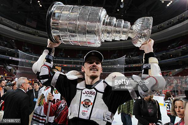 Tomas Kopecky of the Chicago Blackhawks hoists the Stanley Cup after teammate Patrick Kane scored the gamewinning goal in overtime to defeat the...