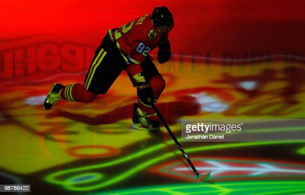 Tomas Kopecky of the Chicago Blackhawks skates onto the ice during player introductions before the Blackhawks take on the Vancouver Canucks in Game...