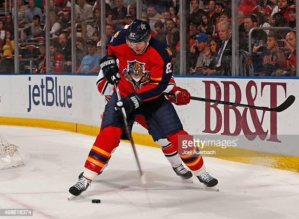 Tomas Kopecky of the Florida Panthers attempts to pass the puck in front of the net against the Carolina Hurricanes at the BBT Center on April 2 2015...