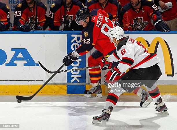 Tomas Kopecky of the Florida Panthers carries the puck along the boards while being defended by Dainius Zubrus of the New Jersey Devils in Game Five...
